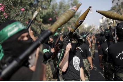 hamas warns israel not to respond to teenage boys murders